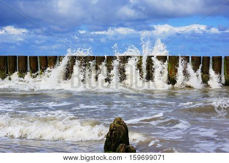water pierce through the breakwater on the Baltic Sea Poland