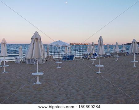 Beach In Twilight With Beach Chairs And Umbrellas (bulgaria, Sunny Beach)
