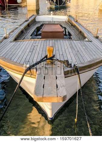 view of an old wooden boat anchored during sunset