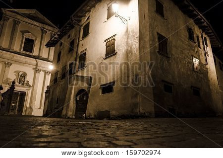 night view of a traditional village on italian alps Borgo Valsugana