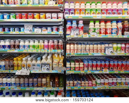 CHIANG RAI THAILAND - NOVEMBER 25: various brand of pasteurized milk in packaging for sale on supermarket stand or shelf in Seven Eleven on November 25 2016 in Chiang rai Thailand.