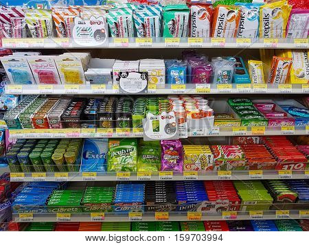 CHIANG RAI THAILAND - NOVEMBER 25: various brand of lozenge and gum in packaging for sale on supermarket stand or shelf in Seven Eleven on November 25 2016 in Chiang rai Thailand.