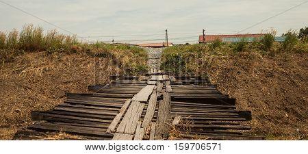 Old temporary wooden bridge in Phatumthani Thailand