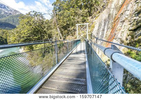 Step on a suspension bridge at Blue Pool New Zealand