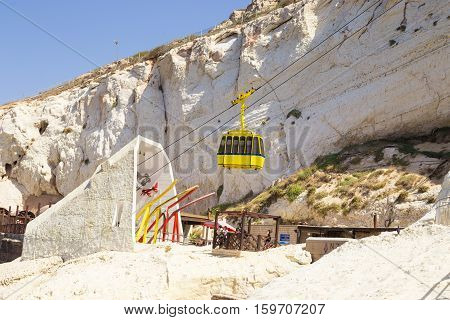 ROSH HANIKRA ISRAEL - CIRCA SEP 2016: Ropeway above the grotto yellow cab goes down