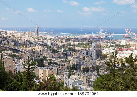 Panoramic view of Haifa Israel. City streets trees sea port and skyscrapers