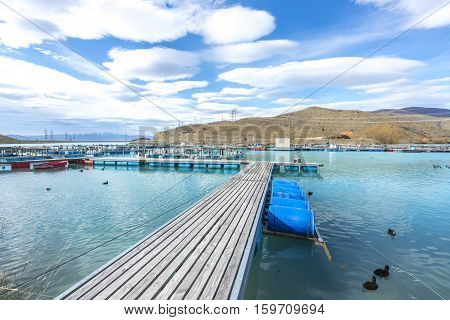 Salmon Fish farm floating on the glacial waters of Wairepo Arm Twizel South Island New Zealand