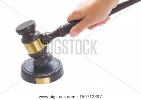 Hand holding Wooden Law Gavel isolated over white background