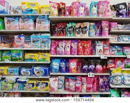 CHIANG RAI THAILAND - NOVEMBER 26: various brand of fabric softener and diaper in packaging for sale on supermarket stand or shelf in Seven Eleven on November 26 2016 in Chiang rai Thailand