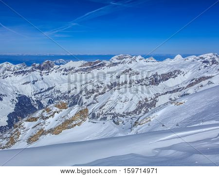 View from Mt. Titlis in Switzerland in winter. Titlis is a mountain, located on the border between the Swiss Cantons of Obwalden and Bern.