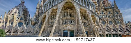 Detailed panoramic view on the bottom part of Sagrada Familia in Barcelona, summer Spain