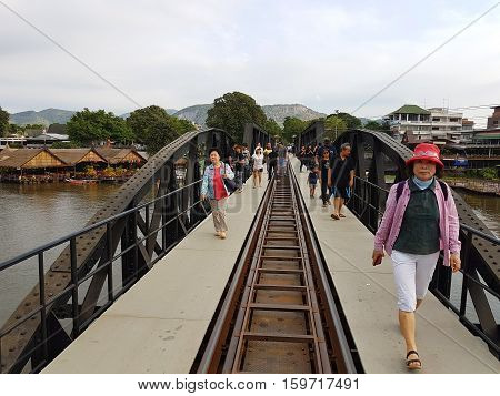 KANCHANABURI THAILAND - NOVEMBER 26: unidentified asian people walking on Bridge on the river Kwai on November 26 2016 in Kanchanaburi Thailand