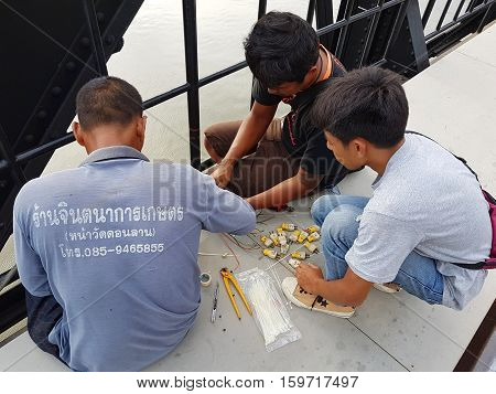 KANCHANABURI THAILAND - NOVEMBER 26: unidentified asian men working on Bridge on the river Kwai on November 26 2016 in Kanchanaburi Thailand