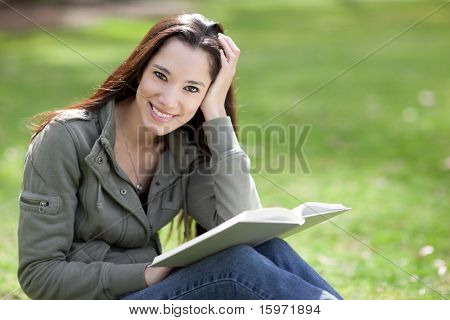 A shot of an ethnic college student studying on campus