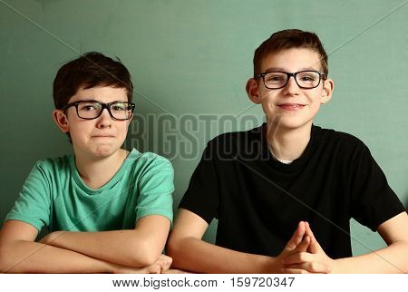 Two Teenager Boys In Myopia Glasses Close Up