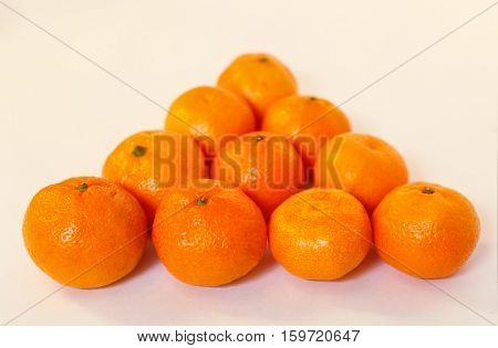 fresh tangerines peeled in bowl fresh tangerines in a billiards triangle at the table