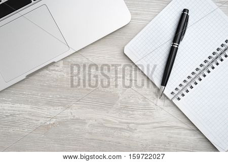 Notepad With Pen And Laptop