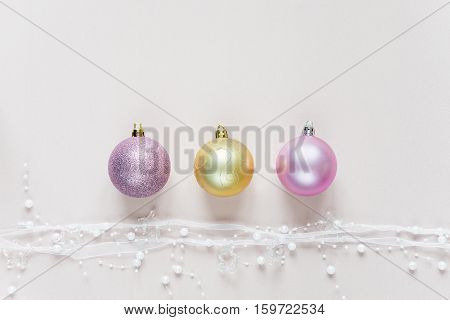 Beautiful Christmas composition with Christmas balls on a pink background. Flat lay composition for greeting cards websites social media magazines bloggers artists etc. Christmas wallpaper