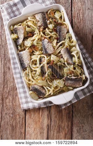 Italian Food: Pasta With Sardines, Fennel, Raisins And Pine Nuts Close Up In Baking Dish. Vertical T