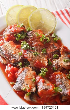 Tasty Sardines In Tomato Sauce With Lime And Parsley Close-up. Vertical
