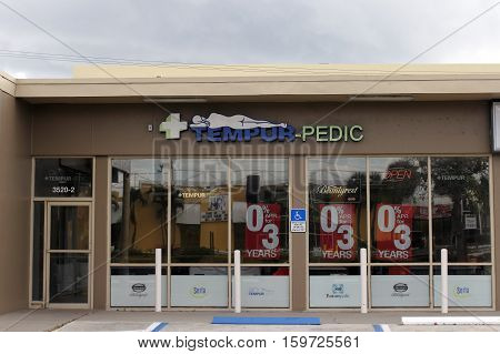 Fort Lauderdale FL USA - April 24 2016: Tempur-Pedic storefront and signage in a days morning. Directly outside the front of a sleeping mattress retail shop location.