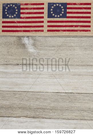 USA patriotic Betsy Ross old flag on a weathered wood background with copy space for your message