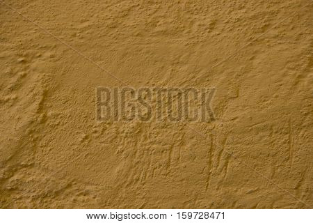 Beige yellow old grunge wall texture, concrete cement background