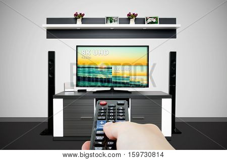 Watching television in modern TV room. Compare of television resolution. uhd 8k television resolution ultra hd concept
