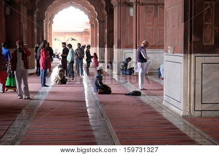 DELHI, INDIA - FEBRUARY 13 : People praying at the Jama Masjid Mosque on February 13, 2016, Delhi, India.