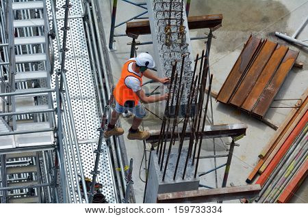 Aerial view of unrecognized construction worker work in a construction site. Building development concept with copy space