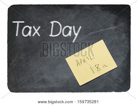Tax Day Concept Using Chalk On Slate Blackboard