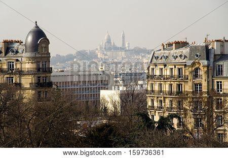 View of the Basilica Sacre-Coeur from the park des Buttes-Chaumont Paris France