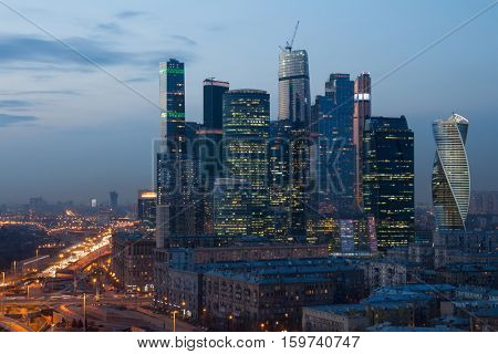 MOSCOW - APR 8, 2016: Futuristic Moscow International Business Center (MIBC) under construction at evening. East tower of complex Federation in height 374 m - highest skyscraper in Europe