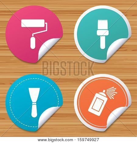 Round stickers or website banners. Paint roller, brush icons. Spray can and Spatula signs. Wall repair tool and painting symbol. Circle badges with bended corner. Vector