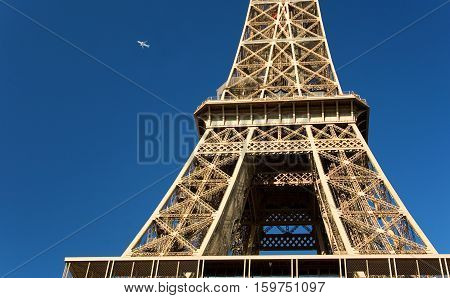 Leaving Paris. Fragment of the Eiffel Tower and a plane