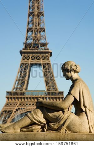 Statue of woman at the Trocadero looking at the Eiffel Tower. Paris France