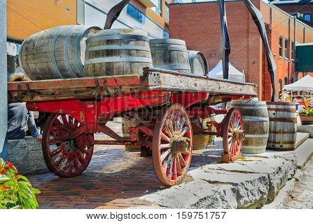gorgeous amazing closeup rear view of vintage classic horse drawn carriage loaded with wooden barrels