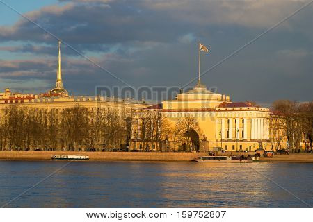 SAINT-PETERSBURG, RUSSIA - APRIL 23, 2016: The Admiralty embankment at sunset evening in April. The historical landmark of the city Saint Petersburg