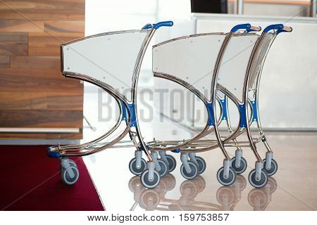 Three airport luggage carts in an international airport