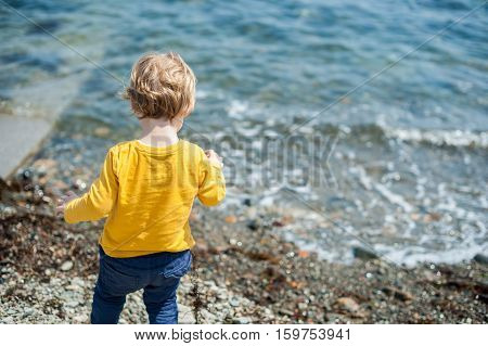 Boy Looks At The Sea