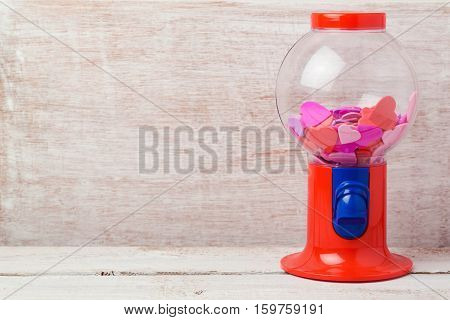 Valentine's day background with gumball machine and heart shapes