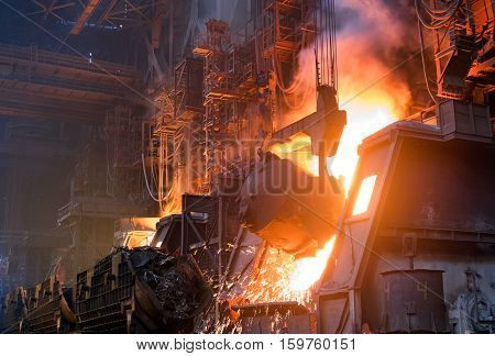pouring cast iron into the converting furnace to produce steel