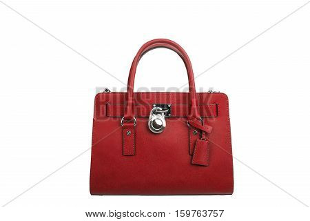 Red leather handbag isolated on white background
