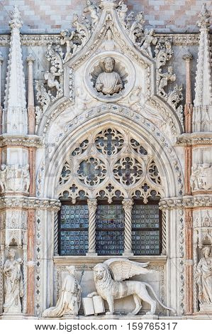 Architectural detail of Basilica of Saint Mark (Venice Italy). Vertically. Closeup view of sculpture of Doge and Venetian lion.