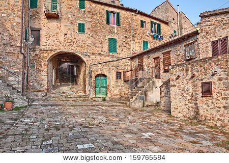 Seggiano, Grosseto, Tuscany, Italy: ancient square alley and underpass in the old town of the medieval village on the tuscan mountain