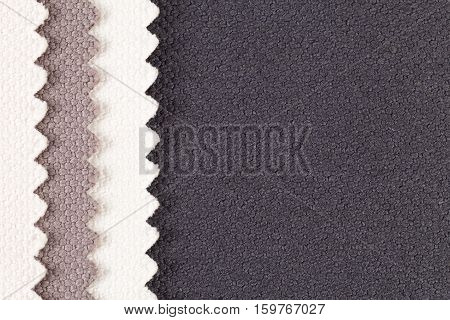 Background composition of colored vertical stripes of serrated cotton fabric.place for text