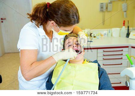 Boy Is Treated By Female Dentist