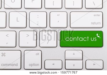Contact us word written on computer keyboard.