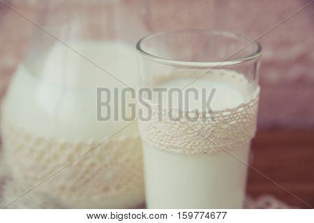 glass jar of milk on a light background