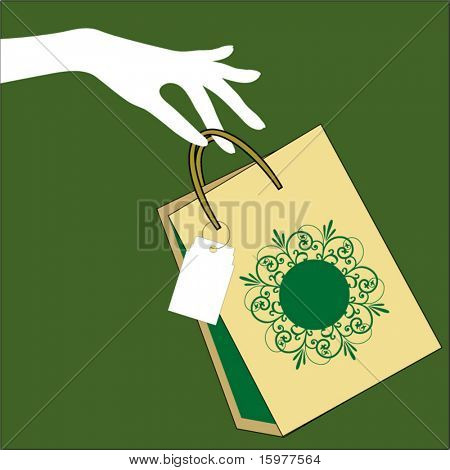 hand holding shopping bag with tag
